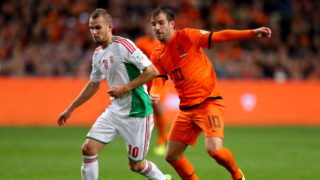 AMSTERDAM, NETHERLANDS - OCTOBER 11:  Vladimir Koman of Hungary (L) in action with Rafael van der Vaart of Holland during the FIFA 2014 World Cup Qualifing match between Holland and Hungary at Amsterdam Arena on October 11, 2013 in Amsterdam, Netherlands.  (Photo by Scott Heavey/Getty Images)