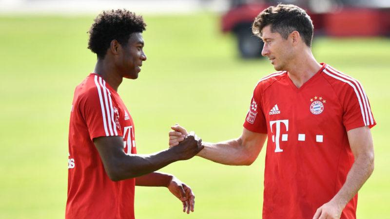 MUNICH, GERMANY - JULY 10: David Alaba (L) and Robert Lewandowski of FC Bayern Muenchen shake hands during a training session at Saebener Strasse training ground on July 10, 2017 in Munich, Germany. (Photo by Sebastian Widmann/Bongarts/Getty Images)