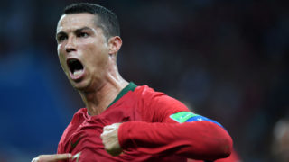 SOCHI, RUSSIA - JUNE 15:  Cristiano Ronaldo of Portugal celebrates scoring his side's third goal and a hat trick during the 2018 FIFA World Cup Russia group B match between Portugal and Spain at Fisht Stadium on June 15, 2018 in Sochi, Russia.  (Photo by Etsuo Hara/Getty Images)