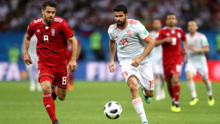 KAZAN, RUSSIA - JUNE 20:  Diego Costa of Spain challenge for the ball with Morteza Pouraliganji of Iran  during the 2018 FIFA World Cup Russia group B match between Iran and Spain at Kazan Arena on June 20, 2018 in Kazan, Russia.  (Photo by Francois Nel/Getty Images)