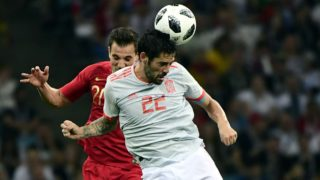 Portugal's defender Cedric Soares (L) and Spain's midfielder Isco compete for the ball during the Russia 2018 World Cup Group B football match between Portugal and Spain at the Fisht Stadium in Sochi on June 15, 2018. / AFP PHOTO / PIERRE-PHILIPPE MARCOU / RESTRICTED TO EDITORIAL USE - NO MOBILE PUSH ALERTS/DOWNLOADS