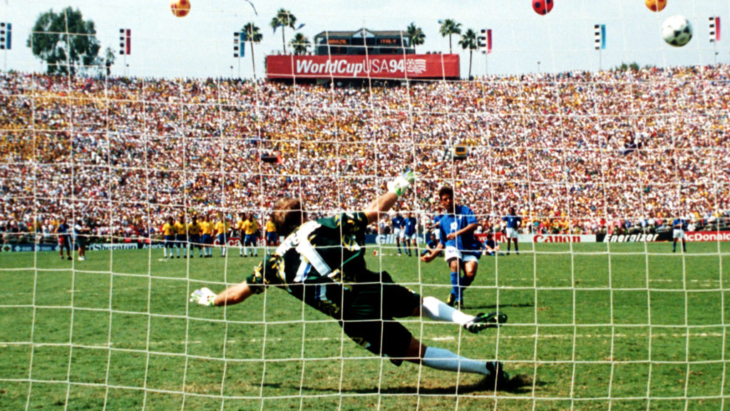 Italian forward Roberto Baggio kicks the ball but misses the goal in a penalty kick while the Brazilian goalkeeper Taffarel dives for the ball during the 1994 World Cup final Brazil against Italy in Pasadena, USA, 17 July 1994. The Brazilian team won the game 3-2 against Italy on penalties and won the world champion title for the fourth time.