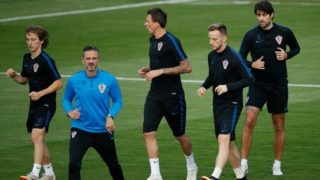 From L: Croatia's midfielder Luka Modric, Croatia's forward Mario Mandzukic, Croatia's midfielder Ivan Rakitic and Croatia's defender Vedran Corluka attend a training session at a training field outside the Luzhniki Stadium in Moscow on July 13, 2018, two days before the Russia 2018 World Cup final football match between France and Croatia. / AFP PHOTO / Odd ANDERSEN