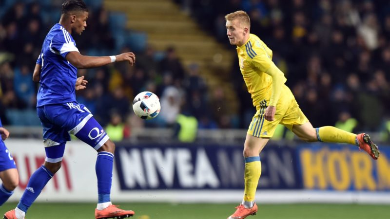 Ivan Petryak (R) of Ukraine and Omar Dossa Momade of Cyprus vie during the friendly football match between Ukraine and Cyprus at Chornomorets Stadium in Odessa on March 24, 2016.  / AFP PHOTO / SERGEI SUPINSKY
