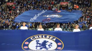 Chelsea fans hold a giant flag in the ANZ stadium during Chelsea's friendly match with Sydney FC in Sydney on June 2, 2015.  AFP PHOTO/ Saeed KHAN --IMAGE RESTRICTED TO EDITORIAL USE - STRICTLY NO COMMERCIAL USE-- / AFP PHOTO / SAEED KHAN