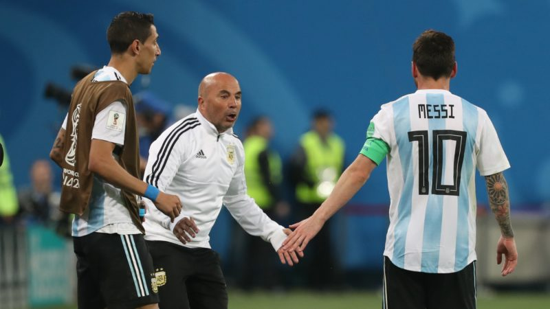 26 June 2018, Russia, Moscow: Soccer, World Cup 2018, Preliminary round, Group D, 3rd game day, Nigeria vs Argentina at the St. Petersburg Stadium: Argentina's coach Jorge Sampaoli (C)and Lionel Messi celebrate after the game. Photo: Cezaro De Luca/dpa