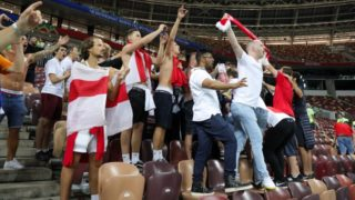 11 July 2018, Russia,Moscow: Soccer, FIFA World Cup 2018, final round, semi-finals: Croatia vs England at Luzhniki Stadium: A small group of England football fans celebrating long after the end of the match in the stands. Photo: Christian Charisius/dpa