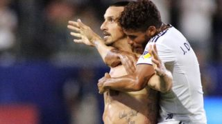 CARSON, CA - JULY 29: Zlatan Ibrahimovic #9 and Jonathan Dos Santos #8 of the Los Angeles Galaxy celebrate Ibrahimovic's third goal of the game at StubHub Center on July 29, 2018 in Carson, California.   Katharine Lotze/Getty Images/AFP