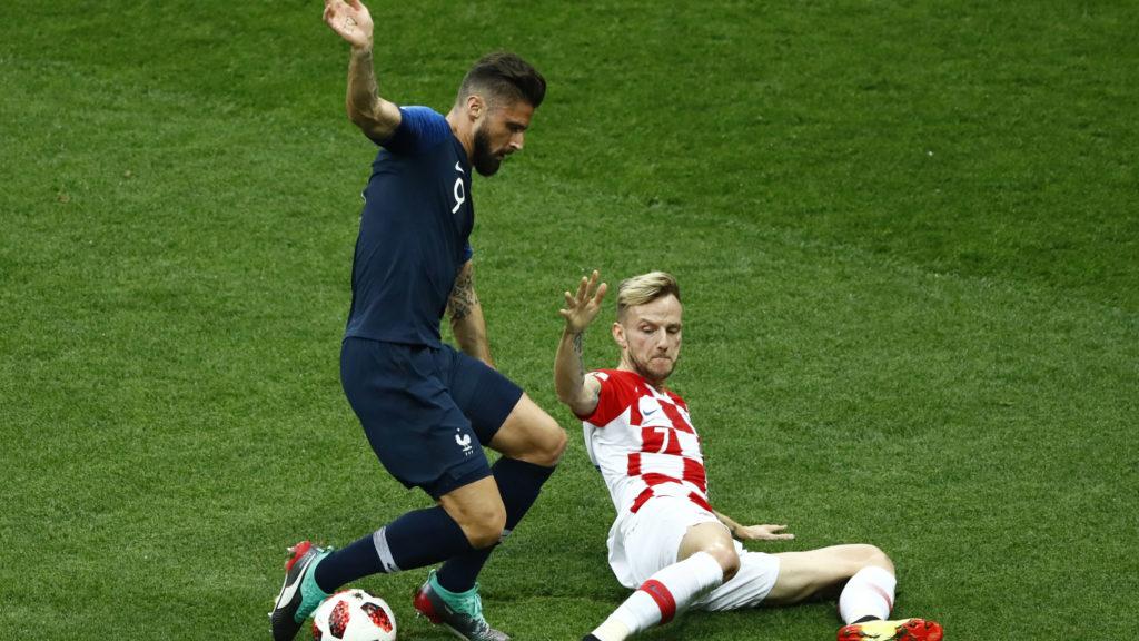 France v Croatia - FIFA World Cup Russia 2018 Final Olivier Giroud (France) and Ivan Rakitic (Croatia) at Luzhniki Stadium in Russia on July 15, 2018. (Photo by Matteo Ciambelli/NurPhoto)