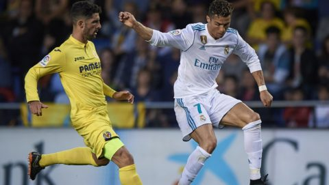 VILLARREAL, SPAIN - MAY 19:  Alvaro Gonzalez (L) of Villarreal competes for the ball with Cristiano Ronaldo of Real Madrid during the La Liga match between Villarreal and Real Madrid at Estadio de la Ceramica on May 19, 2018 in Villarreal, Spain.  (Photo by Quality Sport Images/Getty Images)