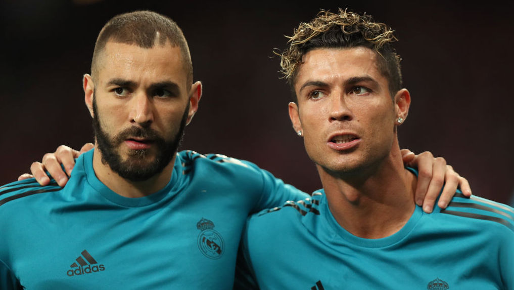 KIEV, UKRAINE - MAY 26: Karim Benzema and Cristiano Ronaldo of Real Madrid warm up before the UEFA Champions League final between Real Madrid and Liverpool on May 26, 2018 in Kiev, Ukraine. (Photo by Matthew Ashton - AMA/Getty Images)