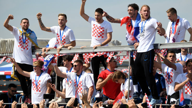 Croatian national football team members ride an open-roof coach in Zagreb International Airport on July 16, 2018 after their return from the FIFA World Cup 2018 in Russia in Zagreb International Airport on July 16, 2018.   / AFP PHOTO / ATTILA KISBENEDEK