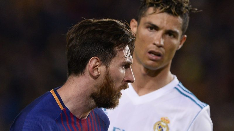 Real Madrid's Portuguese forward Cristiano Ronaldo (R) looks at Barcelona's Argentinian forward Lionel Messi during the Spanish league football match between FC Barcelona and Real Madrid CF at the Camp Nou stadium in Barcelona on May 6, 2018. / AFP PHOTO / Josep LAGO