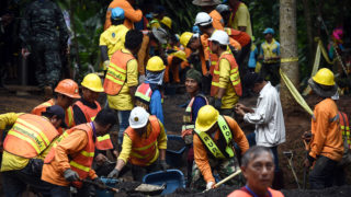 Workers fix the road leading to Tham Luang cave in Khun Nam Nang Non Forest Park following news all members of children's football team and their coach were alive in the cave in Mae Sai district on July 3, 2018. Food and medical help reached 13 members of a Thai youth football team found rake thin but alive, huddled on a ledge deep inside a flooded cave nine days after they went missing, as the focus turned on July 3 to how to get them out.   / AFP PHOTO / Lillian SUWANRUMPHA
