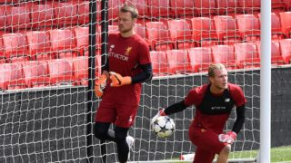 Liverpool's Belgian goalkeeper Simon Mignolet (L) and Liverpool's German goalkeeper Loris Karius attends a training session and media day at Anfield stadium in Liverpool, north west England on May 21, 2018, ahead of their UEFA Champions League final football match against Real Madrid in Kiev on May 26.  / AFP PHOTO / Paul ELLIS