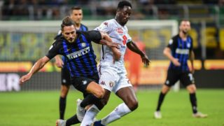 Inter Milan's Italian defender Danilo D'Ambrosio (L) and Torino's French midfielder Souahilo Meite go for the ball during the Italian Serie A football match Inter Milan vs Torino on August 26, 2018 at the San Siro Stadium in Milan. / AFP PHOTO / Miguel MEDINA