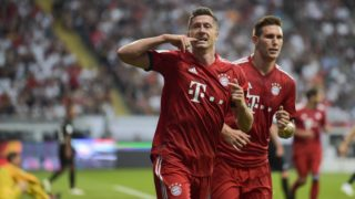 12.08.2018, Germany, Frankfurt am Main: Football: DFL-Supercup, Eintracht Frankfurt - Bayern Munich in the Commerzbank-Arena. Bayern's Robert Lewandowski (l) and Niklas Suele cheer the goal for 0:2. Photo: Silas Stein/dpa - IMPORTANT NOTICE: DFL regulations prohibit any use of photographs as image sequences and/or quasi-video.