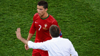 KHARKOV, UKRAINE - JUNE 17:  Cristiano Ronaldo of Portugal speaks with his coach Paulo Bento during the UEFA EURO 2012 group B match between Portugal and Netherlands at Metalist Stadium on June 17, 2012 in Kharkov, Ukraine.  (Photo by Lars Baron/Getty Images)