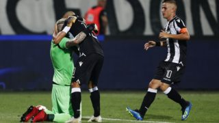 5606820 08.08.2018 From left: PAOK's Alexandros Paschalakis, Dimitris Limnios and Dimitris Pelkas celebrate the team's victory in the UEFA Champions League third qualifying round's first match between PAOK Thessaloniki (Greece) and Spartak Moscow (Russia). Alexander Stupnikov / Sputnik