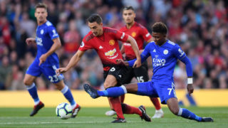 MANCHESTER, ENGLAND - AUGUST 10:  Demarai Gray of Leicester City and Matteo Darmian of Manchester United battle for possession during the Premier League match between Manchester United and Leicester City at Old Trafford on August 10, 2018 in Manchester, United Kingdom.  (Photo by Laurence Griffiths/Getty Images)