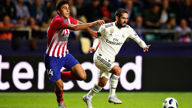 TALLINN, ESTONIA - AUGUST 15:  Isco of Real Madrid (R) is challenged by Rodri of Atletico Madridduring the UEFA Super Cup between Real Madrid and Atletico Madrid at Lillekula Stadium on August 15, 2018 in Tallinn, Estonia.  (Photo by Chris Brunskill/Fantasista/Getty Images)