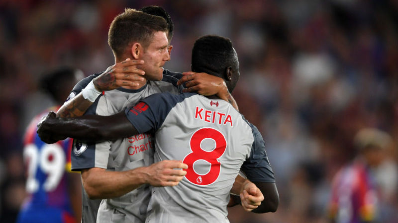 LONDON, ENGLAND - AUGUST 20:  James Milner of Liverpool celebrates with teammates after he scores his sides first goal during the Premier League match between Crystal Palace and Liverpool FC at Selhurst Park on August 20, 2018 in London, United Kingdom.  (Photo by Mike Hewitt/Getty Images)