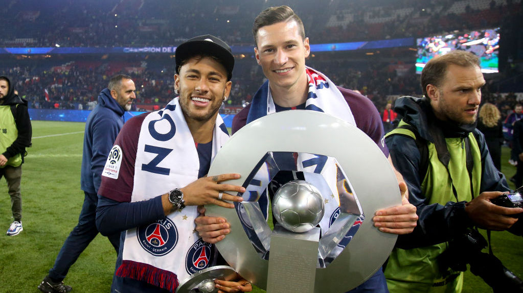 PARIS, FRANCE - MAY 12: Neymar Jr, Julian Draxler of PSG celebrate during the French Ligue 1 Championship Trophy Ceremony following the Ligue 1 match between Paris Saint-Germain (PSG) and Stade Rennais (Rennes) at Parc des Princes stadium on May 12, 2018 in Paris, France. (Photo by Jean Catuffe/Getty Images)