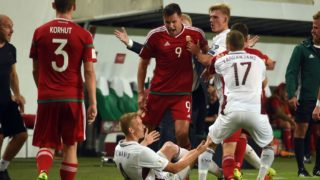 Hungary's Adam Szalai (C) argues with Latvia's Gints Freimanis (on the ground) during the FIFA World Cup 2018 qualification football match between Hungary and Latvia in Budapest on August 31, 2017.  / AFP PHOTO / ATTILA KISBENEDEK