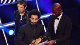 5645434 24.09.2018 Former Ivorian soccer player Didier Drogba, right, and British singer Noel Gallagher, left, present Liverpool's Mohamed Salah of Egypt with the FIFA Puskas Award 2018 trophy during the Best FIFA 2018 Awards Show at Royal Festival Hall in London, England, September 24, 2018. Alexey Filippov / Sputnik