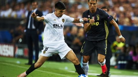 Carlos Soler, Cristiano Ronaldo (R) competes for the ball during the Group H match of the UEFA Champions League between Valencia CF and Juventus at Mestalla Stadium on September 19, 2018 in Valencia, Spain. (Photo by Jose Breton/NurPhoto)