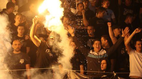BELGRADE, SERBIA - APRIL 14: Partizan fans ignite torches during the Serbian Super League Play Off match between FK Crvena Zvezda and FK Partizan at Rajko Mitic stadium on April 14, 2018 in Belgrade, Serbia. Talha Ozturk / Anadolu Agency