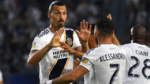 CARSON, CA - AUGUST 11:  Romain Alessandrini #7 gets a high five from Zlatan Ibrahimovic #9 of Los Angeles Galaxy after scoring a goal in the first half of the game against the Minnesota United at StubHub Center on August 11, 2018 in Carson, California.  (Photo by Jayne Kamin-Oncea/Getty Images)