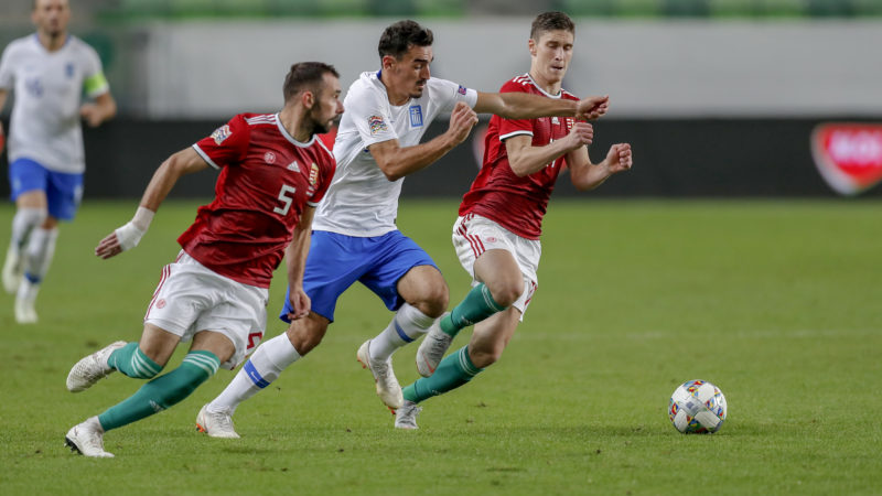 BUDAPEST, HUNGARY - SEPTEMBER 11: Lazaros Christodoulopoulos of Greece (r2) tries to break out between Attila Fiola of Hungary #5 and Roland Sallai of Hungary (r) during the UEFA Nations League group stage match between Hungary and Greece at Groupama Arena on September 11, 2018 in Budapest, Hungary. (Photo by Laszlo Szirtesi/Getty Images)