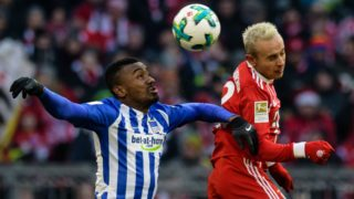 24 February 2018, Germany, Munich: Bundesliga match between Bayern Munich and Hertha BSCin the Allianz Arena. Hertha's Salomon Kalou (l) and Bayern's Rafinha vie for the ball.  (EMBARGO CONDITIONS - ATTENTION: Due to the accreditation guidelines, the DFL only permits the publication and utilisation of up to 15 pictures per match on the internet and in online media during the match.) Photo: Matthias Balk/dpa - (EMBARGO CONDITIONS - ATTENTION: Due to the accreditation guidelines, the DFL only permits the publication and utilisation of up to 15 pictures per match on the internet and in online media during the match.)