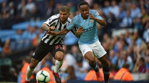 Newcastle United's US defender DeAndre Yedlin (L) vies with Manchester City's English midfielder Raheem Sterling during the English Premier League football match between Manchester City and Newcastle United at the Etihad Stadium in Manchester, north west England, on September 1, 2018. (Photo by Oli SCARFF / AFP) / RESTRICTED TO EDITORIAL USE. No use with unauthorized audio, video, data, fixture lists, club/league logos or 'live' services. Online in-match use limited to 120 images. An additional 40 images may be used in extra time. No video emulation. Social media in-match use limited to 120 images. An additional 40 images may be used in extra time. No use in betting publications, games or single club/league/player publications. /