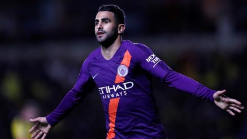 Manchester City's Algerian midfielder Riyad Mahrez celebrates scoring his team's second goal during the English League Cup third round football match between Oxford United and Manchester City at the Kassam Stadium in Oxford, west of London, on September 25, 2018. / AFP PHOTO / Adrian DENNIS / RESTRICTED TO EDITORIAL USE. No use with unauthorized audio, video, data, fixture lists, club/league logos or 'live' services. Online in-match use limited to 120 images. An additional 40 images may be used in extra time. No video emulation. Social media in-match use limited to 120 images. An additional 40 images may be used in extra time. No use in betting publications, games or single club/league/player publications. /