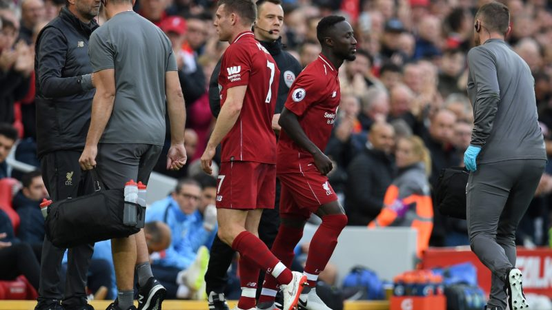 Liverpool's English midfielder James Milner (centre L) leaves the pitch after being substituted off injured for Liverpool's Guinean midfielder Naby Keita (2R) during the English Premier League football match between Liverpool and Manchester City at Anfield in Liverpool, north west England on October 7, 2018. (Photo by Paul ELLIS / AFP) / RESTRICTED TO EDITORIAL USE. No use with unauthorized audio, video, data, fixture lists, club/league logos or 'live' services. Online in-match use limited to 120 images. An additional 40 images may be used in extra time. No video emulation. Social media in-match use limited to 120 images. An additional 40 images may be used in extra time. No use in betting publications, games or single club/league/player publications. /