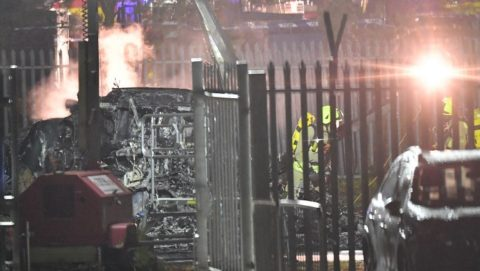 Emergency services work at the scene on the wreckage of a helicopter that crashed in a car park outside Leicester City Football Club's King Power Stadium in Leicester, eastern England, on October 27, 2018. - A helicopter on Saturday crashed near the football stadium in the central UK city of Leicester, police said. The crash took place hours after Leicester drew 1-1 with West Ham in a Premier League match at the King Power Stadium. Sky Sports broadcast pictures of what it said was the helicopter in flames, reporting it belonged to Leicester City Football Club's Thai owner Vichai Srivaddhanaprabha. (Photo by Ben STANSALL / AFP)