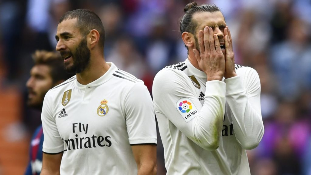 Real Madrid's Welsh forward Gareth Bale (R) reacts next to Real Madrid's French forward Karim Benzema during the Spanish league football match Real Madrid CF against Levante UD at the Santiago Bernabeu stadium in Madrid on October 20, 2018. (Photo by GABRIEL BOUYS / AFP)