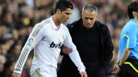 """Real Madrid's Portuguese forward Cristiano Ronaldo (L) listens to with Real Madrid's Portuguese coach Jose Mourinho (R) during the Spanish League """"El clasico"""" football match Barcelona vs Real Madrid at the Camp Nou stadium in Barcelona on April 21, 2012.  AFP PHOTO/JAVIER SORIANO (Photo by JAVIER SORIANO / AFP)"""