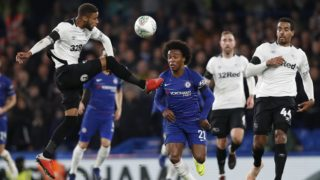 Derby County's English defender Jayden Bogle (L) vies with Chelsea's Brazilian midfielder Willian during the English League Cup football match between Chelsea and Derby County at Stamford Bridge in London on Octopber 31, 2018. (Photo by Adrian DENNIS / AFP) / RESTRICTED TO EDITORIAL USE. No use with unauthorized audio, video, data, fixture lists, club/league logos or 'live' services. Online in-match use limited to 120 images. An additional 40 images may be used in extra time. No video emulation. Social media in-match use limited to 120 images. An additional 40 images may be used in extra time. No use in betting publications, games or single club/league/player publications. /