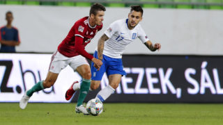 BUDAPEST, HUNGARY - SEPTEMBER 11: (l-r) Adam Nagy of Hungary competes for the ball with Anastasios Donis of Greece during the UEFA Nations League group stage match between Hungary and Greece at Groupama Arena on September 11, 2018 in Budapest, Hungary. (Photo by Laszlo Szirtesi/Getty Images)