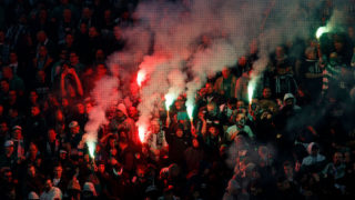 BUDAPEST, HUNGARY - NOVEMBER 4: The ultras (called Green Monsters) light fire during the Hungarian OTP Bank Liga match between Ferencvarosi TC and DVSC at Groupama Arena on November 4, 2017 in Budapest, Hungary. The ultras of Ferencvarosi TC have returned after three years long boycott. (Photo by Laszlo Szirtesi/Getty Images)