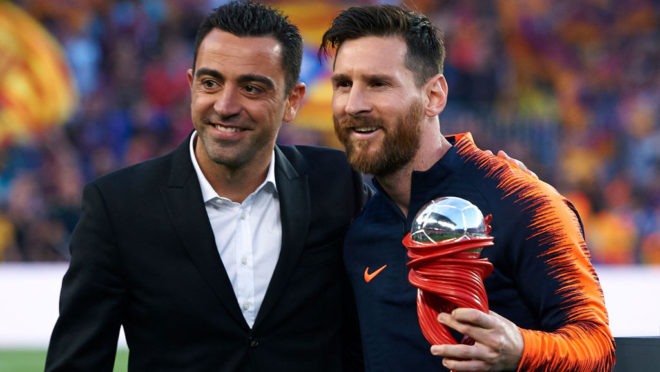 BARCELONA, SPAIN - MAY 20:  Xavi Hernandez gives Lionel Messi of Barcelona the trophy to the best player of the month prior the La Liga match between Barcelona and Real Sociedad at Camp Nou on May 20, 2018 in Barcelona, Spain.  (Photo by Quality Sport Images/Getty Images)