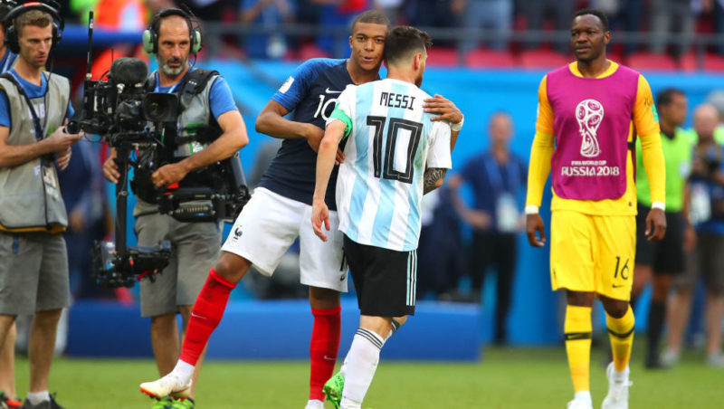 KAZAN, RUSSIA - JUNE 30:   Kylian Mbappe of France embraces Lionel Messi of Argentina at the end of the 2018 FIFA World Cup Russia Round of 16 match between France and Argentina at Kazan Arena on June 30, 2018 in Kazan, Russia. (Photo by Robbie Jay Barratt - AMA/Getty Images)