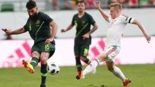 Hungary's Kevin Varga (R) vies for the ball with Australia's Mile Jedinak during the international friendly footbal match Hungary vs Australia in Budapest, on June 9, 2018. / AFP PHOTO / FERENC ISZA