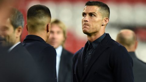 Juventus' Portuguese striker Cristiano Ronaldo joins teammates during a walkabout inside Old Trafford stadium in Manchester, north west England on October 22, 2018, on the eve of their UEFA Champions League group H football match against Manchester United on October 23. (Photo by Oli SCARFF / AFP)