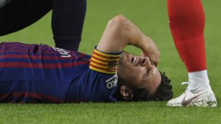 Barcelona's Argentinian forward Lionel Messi gestures in pain during the Spanish league football match FC Barcelona against Sevilla FC at the Camp Nou stadium in Barcelona on October 20, 2018. (Photo by LLUIS GENE / AFP)