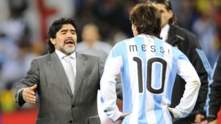 Argentina's coach Diego Maradona (L) looks dejected in front of Argentina's striker Lionel Messi after they lost the 2010 World Cup quarter-final football match Argentina vs. Germany on July 3, 2010 at Green Point stadium in Cape Town. Germany qualified for the semi-finals.  NO PUSH TO MOBILE / MOBILE USE SOLELY WITHIN EDITORIAL ARTICLE -    AFP PHOTO / DANIEL GARCIA / AFP PHOTO / DANIEL GARCIA