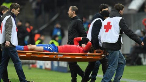 CSKA Moscow's Russian defender Mario Fernandes is stretchered off during the UEFA Champions League group G football match between PFC CSKA Moscow and AS Roma at the Luzhniki stadium in Moscow on November 7, 2018. (Photo by Yuri KADOBNOV / AFP)